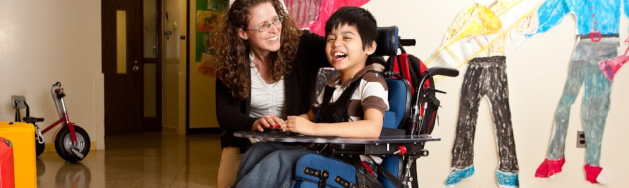 Adult with child in wheelchair